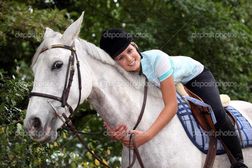 Young woman hugging her horse — Stock Photo #8393005