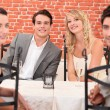Friends at table — Stock Photo #8400186