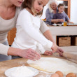 Stock Photo: Mothers and daughter cooking together