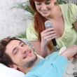 Man with guitar woman with microphone — Stock Photo