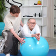 Fitness coach giving a personal training to a senior lady — Stock Photo