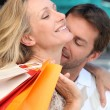 Man tenderly kissing her wife in the neck — Stock Photo