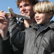 Little boy holding model plane — Stock Photo