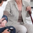 Stock Photo: Taking blood pressure