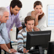 Adults around computer — Stock Photo #8402990