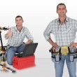 Stockfoto: Twin craftsmen with tools
