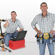 Stock Photo: Twin craftsmen with tools