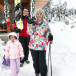 Family enjoying skiing holiday — Stock Photo