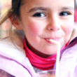 Young girl drinking glass of orange juice — Stok Fotoğraf #8405736
