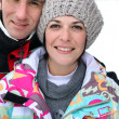Middle-aged couple on a skiing holiday together - Stock Photo