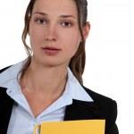 Brunette administrator holding yellow folder — Stock Photo #8406488
