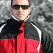 Man in a ski jacket and sunglasses — Stock Photo