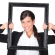 Woman holding empty art frame — Stock Photo