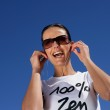 Ecstatic woman listening to her mp3 player — Stock Photo