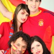 Four Spanish football supporters — Stock Photo