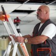 Building professional working on a suspended ceiling — Stock Photo