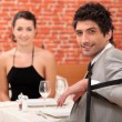 Stock Photo: Couple sharing romantic dinner together