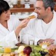 Couple eating breakfast — Stock Photo #8409265