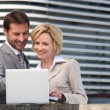 Businessman and woman looking at laptop — Stock Photo