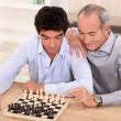 Father and son playing chess — Stock Photo #8409469
