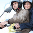 Stock Photo: Couple riding scooter