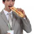Stock Photo: Businessmhaving lunch