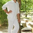 Stock Photo: Mdressed in white stood in forrest