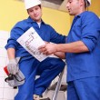 Workers discussing a drawing — Stock Photo