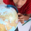 Stock Photo: Schoolboy interested in geography