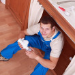 Plumber sat working — Stock Photo #8409926