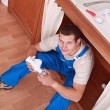 Stock Photo: Plumber sat working
