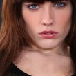 Close-up portrait of attractive brunette looking worried — Stock Photo #8409960