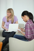 Young women working on a university project together — Stockfoto
