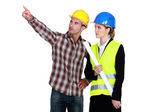 Fore man pointing next to architect — Stock Photo
