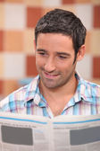 35 years old man reading newspaper — Stock Photo