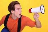 Man shouting into megaphone — Stock Photo