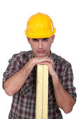 Craftsman holding wooden boards — Stock Photo