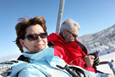 Couple on ski-lift — Stock Photo