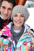 Middle-aged couple on a skiing holiday together — Stock Photo