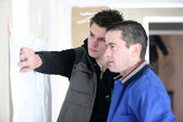 Craftsmen looking at a plan — Stock Photo