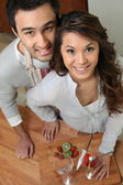High angle shot of couple all smiles slicing fruits — Stock Photo