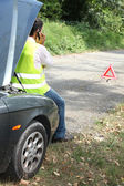 Man sat by car waiting for roadside assistance — Stock Photo