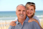 Portrait of a couple on the beach — Stock Photo