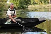 Muž rybolov — Stock fotografie