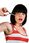 Brunette with scissors — Stock Photo