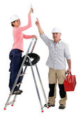Experienced tradesman pointing to his assistant — Stock Photo