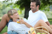 Couple relaxing on the grass — Stock Photo
