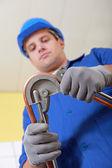 Craftsman bending a pipe — Stock Photo