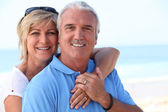 Middle aged couple at the beach. — Stock Photo