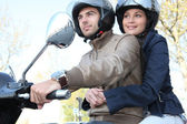Couple riding a scooter — Stock Photo